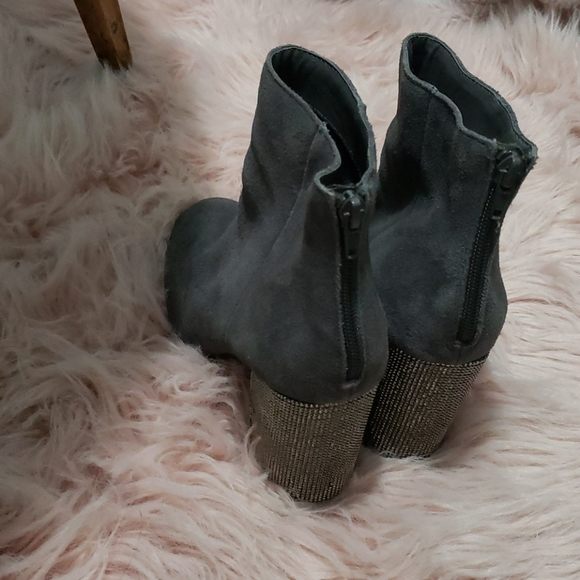 A pair of Kenneth Cole booties